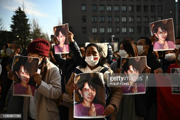 Group of Myanmar activists hold the portrait of Aung San Suu Kyi during a protest outside the United Nation university in Tokyo on February 1, 2021...