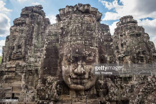 group of mystery face on the tower of bayon temple in siem reap, cambodia. - bas relief stock pictures, royalty-free photos & images