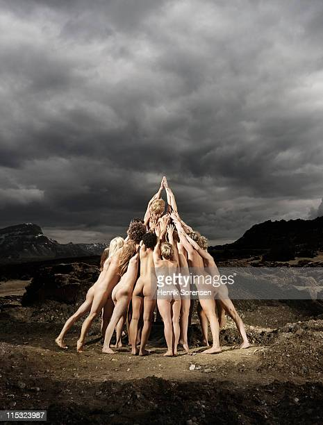 group of naked people forming a pyramid - young nude teenagers stock-fotos und bilder