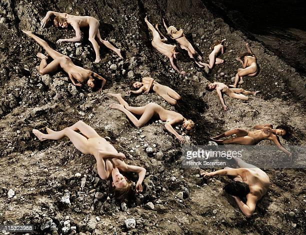 group of naked young people lying on the ground