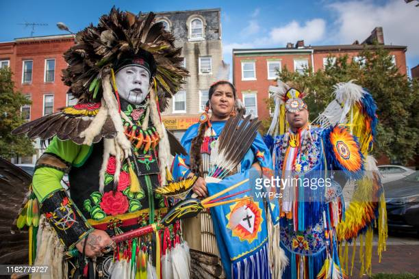 Group of Native Americans dancers belonging to the Lumbee tribe stand in traditional costumes on the streets of Baltimore Maryland
