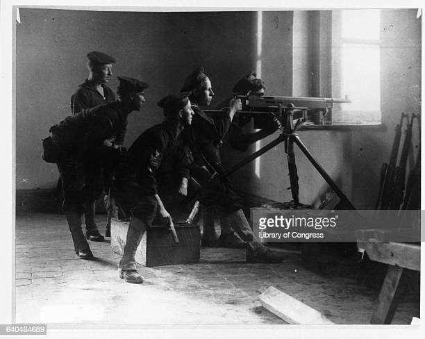 A group of Navy sailors shoot their machine gun from a window in Veracruz The United States invaded Veracruz in 1914 in an attempt to put down the...