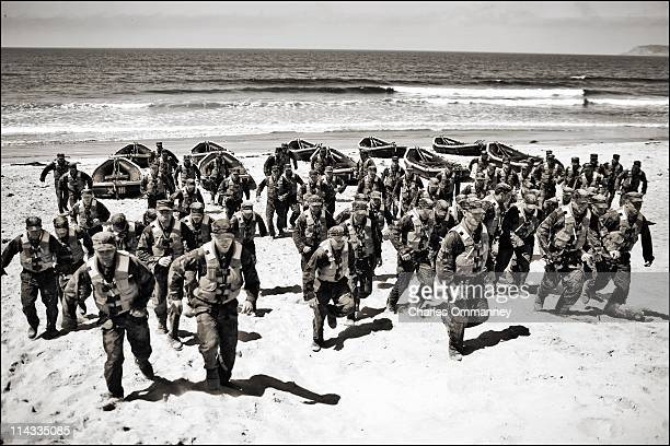 A group of Navy Seal trainees in August of 2010 during Hell Week at a beach in Coronado California Hell Week at this beach in San Diego is exactly...