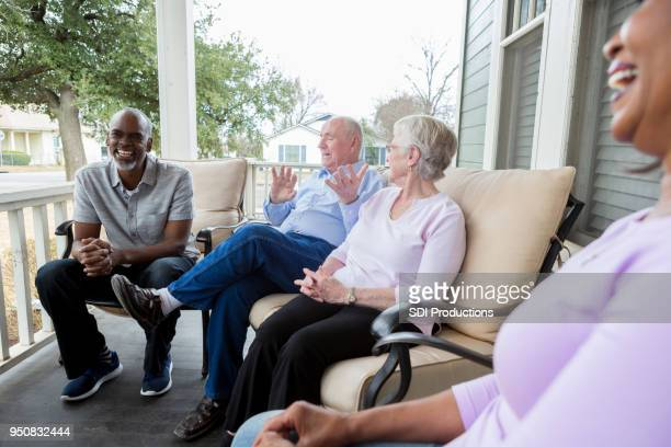 group of neighbors enjoy one another's company - retirement community stock pictures, royalty-free photos & images