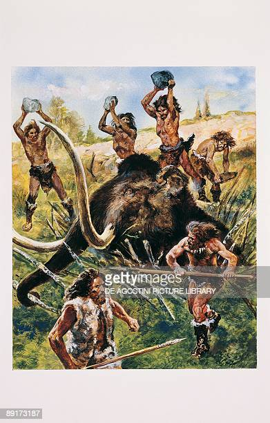 Group of neolithic people hunting an elephant