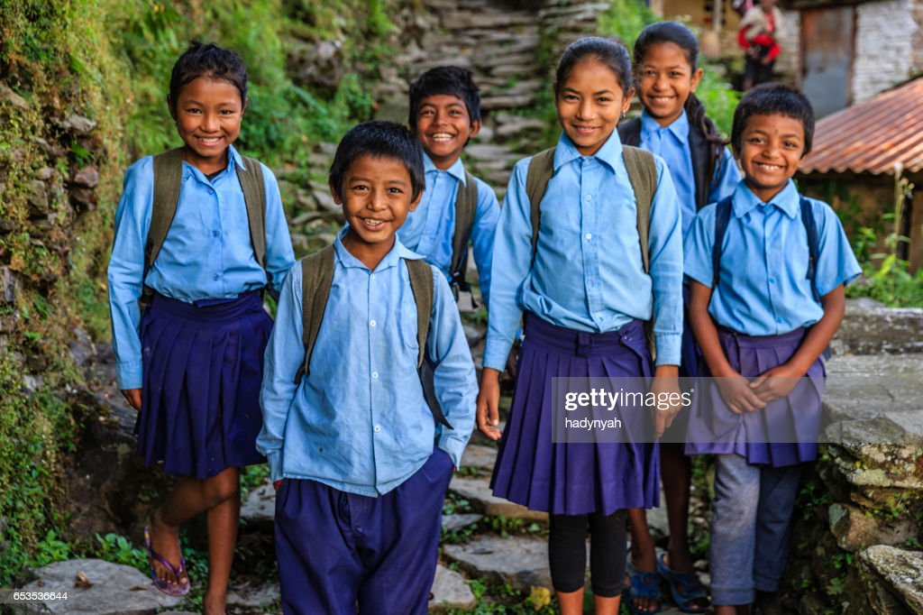 Group of Nepalese school children  in village near Annapurna Range : Stock Photo