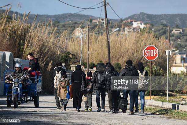 Group of new arrived refugees from Syria walking in direction of Mitilini harbour . Mitilini, Lesvos Island, Greece. On Tuesday, January 12, 2016.