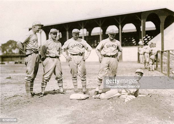 GAINESVILLE FLORIDA MARCH 1919 A group of New York Giants take sliding practice in the pits at their spring training facility in Gainesville Florida...