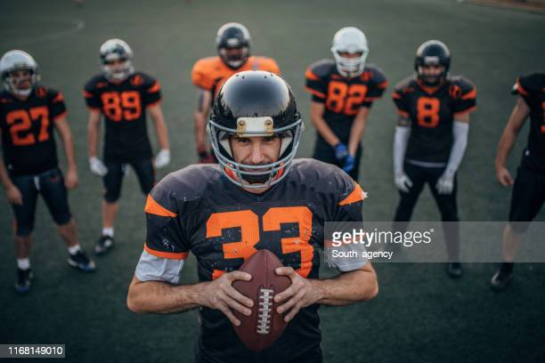 group of nfl players on practice - ncaa stock pictures, royalty-free photos & images