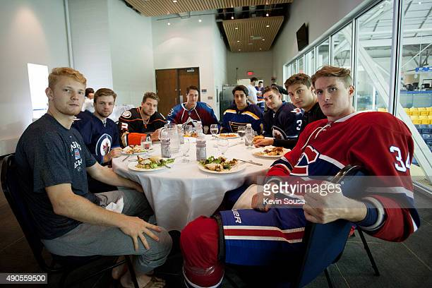 A group of NHL rookies and prospects take a break for lunch at the 2015 NHLPA Rookie Showcase at Mattamy Athletic Centre on September 1 2015 in...