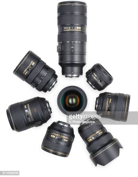 A group of Nikon DSLR lenses including an AFS 1424mm f/28G ED AFS 24mm f/14G ED AFS DX 1755mm f/28G IFED AFS 2470mm f/28E ED VR AFS 50mm f/14G AFS...