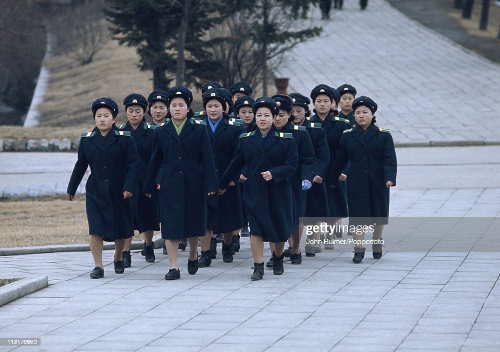 A group of North Korean women marching in uniform, North Korea, February 1973.