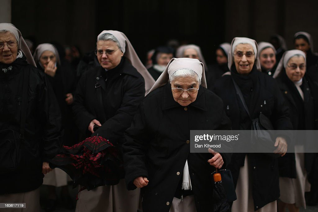 A group of nuns board a bus in heavy rain on March 13, 2013 in Vatican City, Vatican. Argentinian Cardinal Jorge Mario Bergoglio was later elected as the 266th Pontiff and will lead the world's 1.2 billion Catholics.