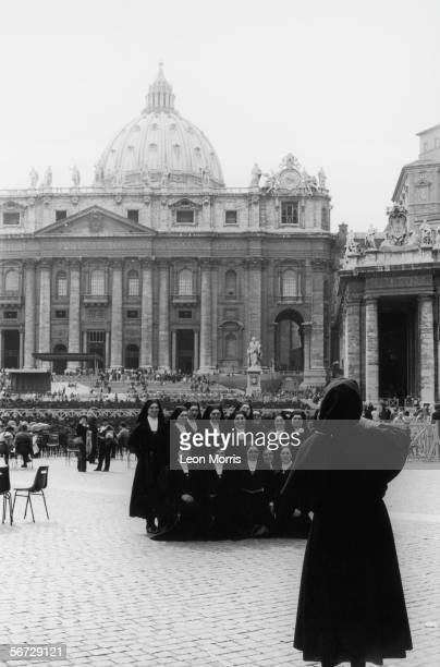 A group of nuns capture their visit to the Basilica of Saint Peter on camera circa 1985