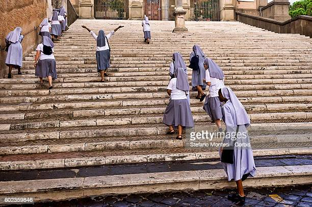 A group of nuns crossing Piazza del Campidoglio on September 9 2016 in Rome Italy