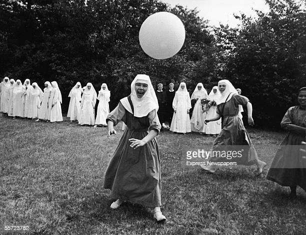A group of nuns play basketball outdoors at the Ladywell Convent Godalming England August 2 1965