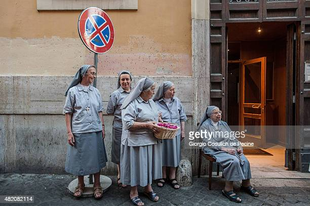 A group of nuns wait in the street the passage of the statue of the 'Madonna della Fiumarola' as she is carried in procession during the closing of...