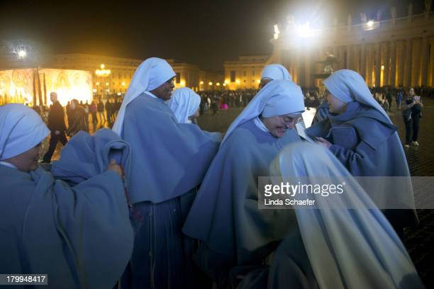 CONTENT] Group of nuns waiting in the long line to enter St Peter's Basilica for the Christmas Eve Mass It would become the last one given by Pope...