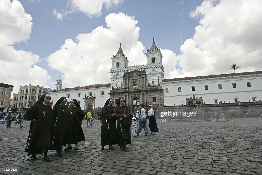A group of nuns walk along the square in front of the Church of San Francisco in the historic center of Quito, 25 January, 2008. The city of San Francisco de Quito was founded by Spanish conquistador, Sebastian de Benalcazar, in 1534 and was the first city to be named a Historical and Cultural World Heritage Site by UNESCO in 1978. AFP PHOTO/Rodrigo BUENDIA