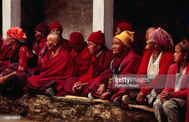 a group of nuns watching the dancing at the mani rimdu festival at chiwang gompa (monastery). - mani rimdu festival stock pictures, royalty-free photos & images