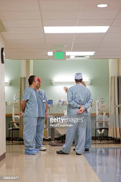 group of nurses in discussion in pre-op area - newhealth stock pictures, royalty-free photos & images