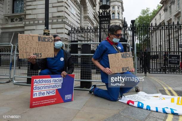 Group of nurses wearing face masks protest outside Downing Street demanding a pay rise, effective protection against COVID-19 and highlighting a...