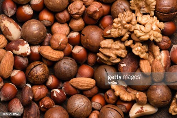 group of nuts as background - nut food stock pictures, royalty-free photos & images
