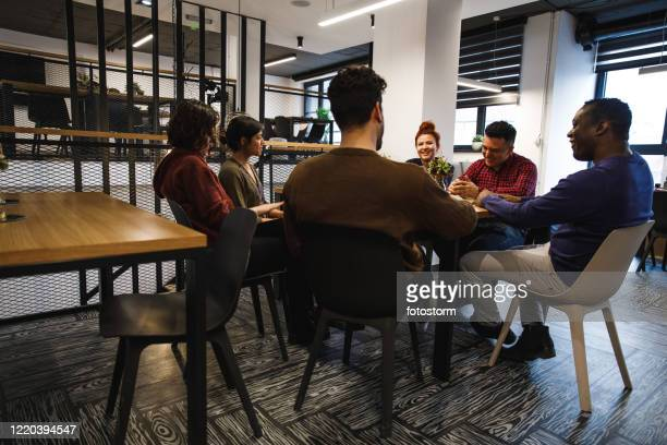 group of office coworkers sharing enjoyable time together - hub stock pictures, royalty-free photos & images