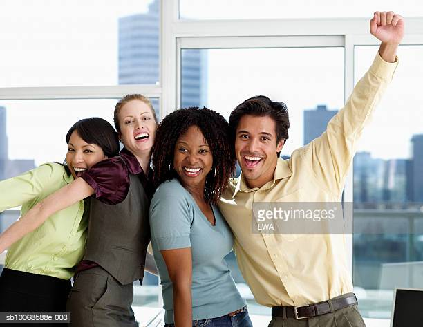 Group of office workers cheering, portrait