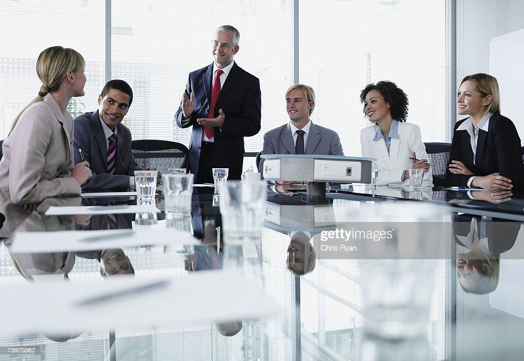 Group of office workers in a boardroom meeting : Stock Photo