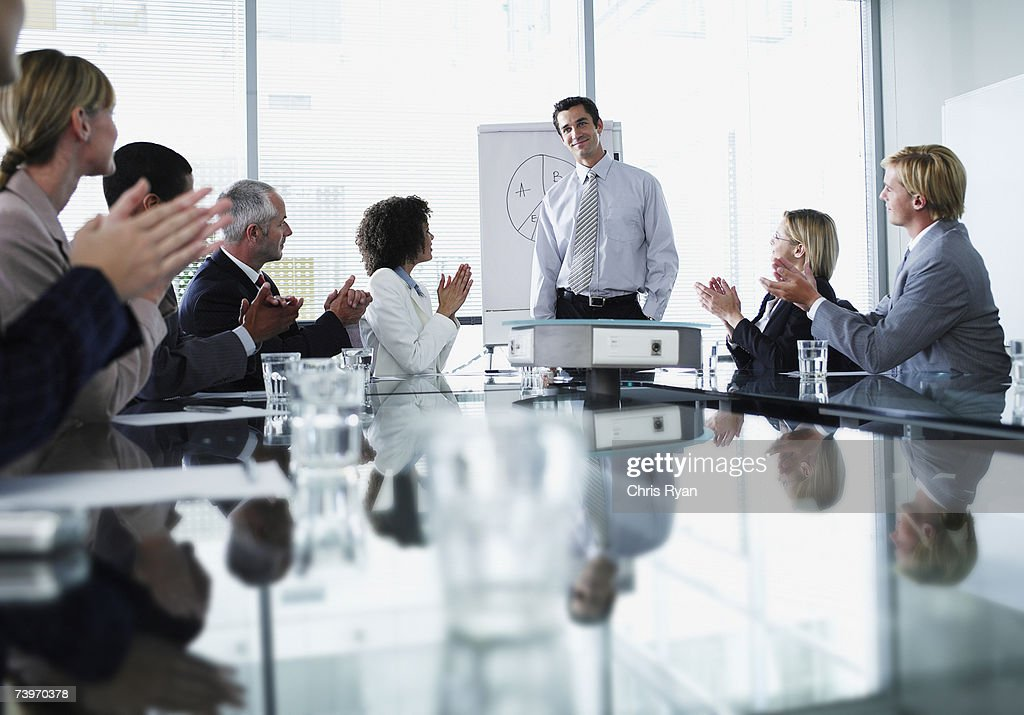 Group of office workers in a boardroom presentation : Stock Photo