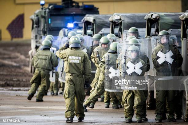 Group of officers of the military police form with protective shields. Shot during an exercise of the land forces on October 13, 2017 in Munster,...