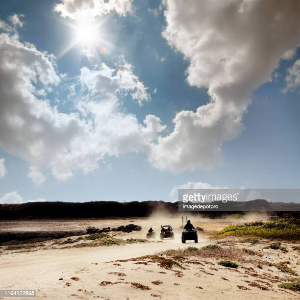 group of off-road vehicles on dusty dirt road - rally car racing stock pictures, royalty-free photos & images