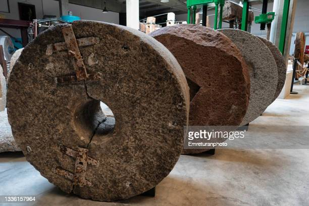 a group of old grinding stones - emreturanphoto stock pictures, royalty-free photos & images