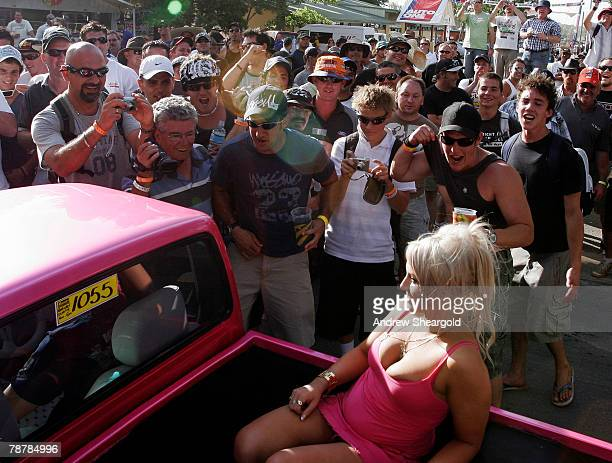 A group of onlookers surround a vehicle with a woman in the back during Street Machine Summernats 21 Car Festival at Epic Park on January 5 2008 in...