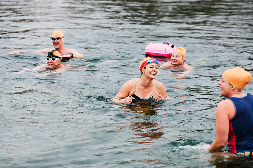 Group of open water swimmers in a lake - gettyimageskorea
