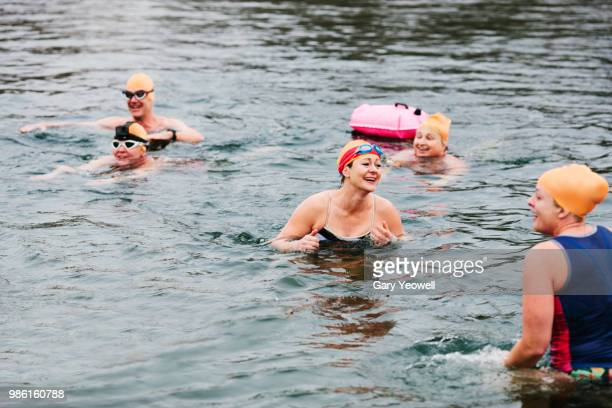 group of open water swimmers in a lake - swimming stock pictures, royalty-free photos & images