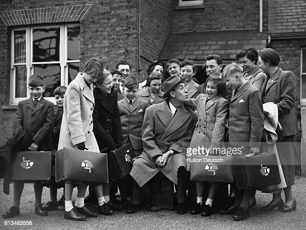 A group of orphans from a Barnardo's orphanage in London prepare to emigrate to Australia Comedian Tommy Trinder sees the children off
