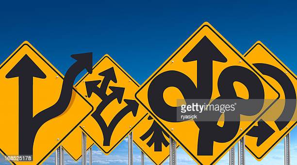 Group Of Overlapping Bizarre Unusual Road Signs on Blue Sky
