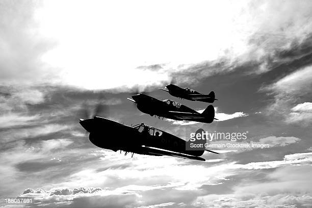 a group of p-40 warhawks fly in formation near nampa, idaho. - curtis p40b warhawk stock pictures, royalty-free photos & images