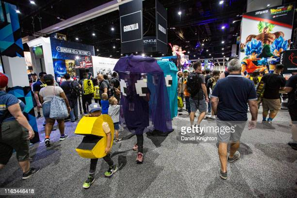 Group of Pacman cosplayers walk the floor at 2019 Comic-Con International on July 21, 2019 in San Diego, California.
