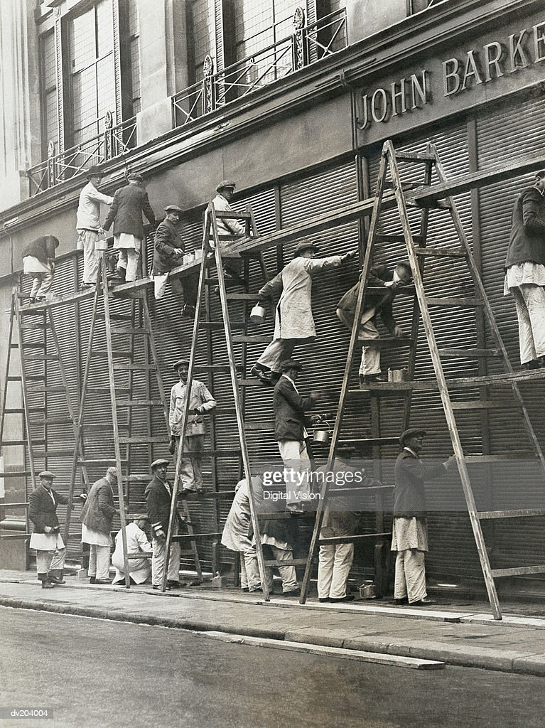 Group of painters on ladders : Stock Photo