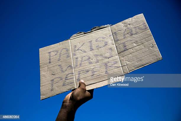 A group of Pakistani migrants protest at their lack of progress obtaining transit papers on August 31 2015 in Kos Greece Migrants from many parts of...