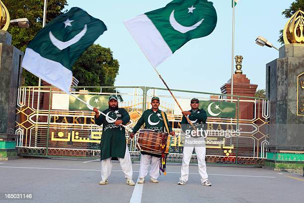 CONTENT] A group of Pakistani people waving the flag with the beats of Drum before the Wahga Border Flag ceremony This ceremony takes place every...
