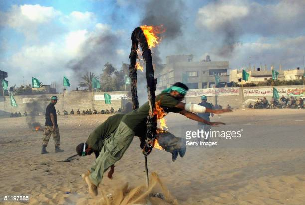 A group of Palestinian Hamas fighters learn techniques on how to invade Israeli settlements during training on August 20 2004 in Gaza City Gaza Strip...