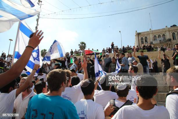 A group of Palestinian stage a protest as Jewish people celebrate the 50th anniversary of Israel's occupation of East Jerusalem at Damascus Gate in...