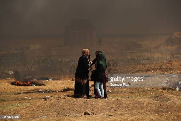 A group of Palestinian women gather at the border fence with Israel as mass demonstrations at the fence continue on May 11 2018 in Gaza City Gaza One...