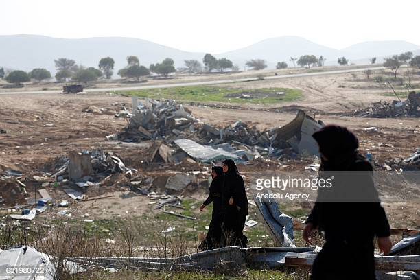 A group of Palestinian women get upset after heavy construction equipments belong to Israel demolished houses at Umm alHiran village in Beersheba...