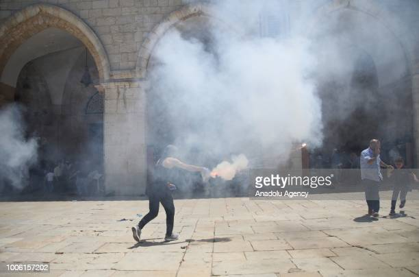 A group of Palestinian youth set off fireworks in response to Israeli forces during a protest against intervention of Israeli forces after they...