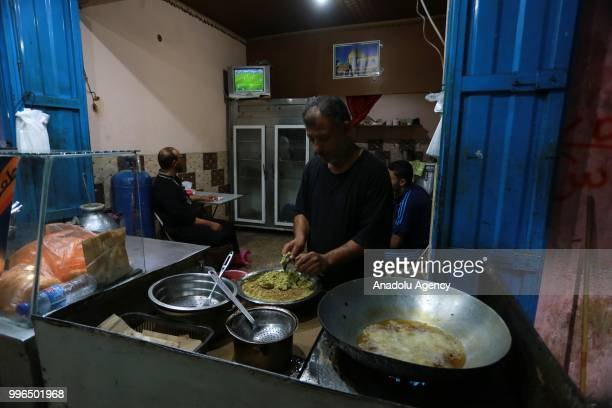 A group of Palestinians gather to watch 2018 FIFA World Cup Russia Semi Final match between Croatia and England on July 11 2018 in Rafah Gaza